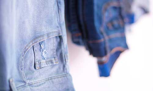 Various pairs of denim jeans